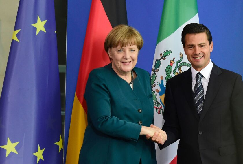 German Chancellor Angela Merkel and Mexican President Enrique Peña Nieto shake hands after talks in Berlin in 2016.