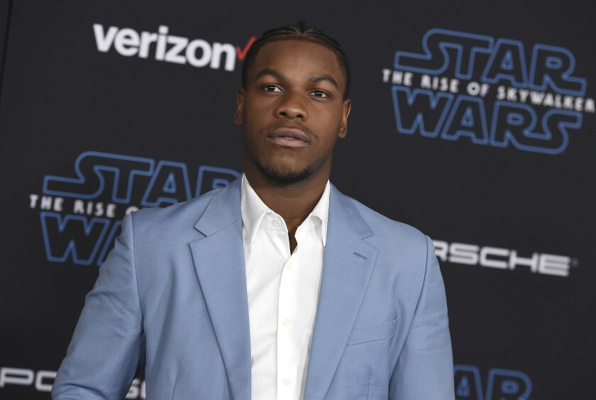 """FILE - In this Monday, Dec. 16, 2019 file photo, John Boyega arrives at the world premiere of """"Star Wars: The Rise of Skywalker"""" in Los Angeles. British perfume brand Jo Malone has apologized to Black actor John Boyega of """"Star Wars"""" fame after cutting him out of the Chinese version of a cologne commercial he helped create. (Jordan Strauss/Invision/AP, File)"""