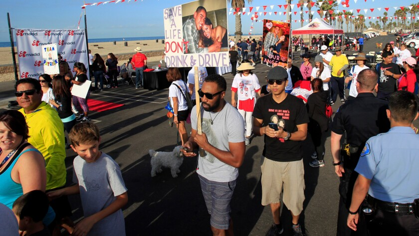 Families, friends and supporters of victims of drunk driving participate in the 9th annual Walk Like MADD (Mothers Against Drunk Driving) in Huntington Beach on Oct. 18, 2014.