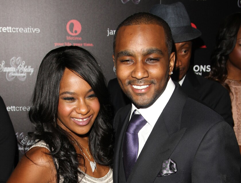 """FILE - In this Oct. 22, 2012, file photo, Bobbi Kristina Brown and Nick Gordon attend the premiere party for """"The Houstons On Our Own"""" at the Tribeca Grand hotel in New York. Gordon, ex-partner of the late Bobbi Kristina Brown, has died. He was 30. Gordon's attorney Joe S. Habachy confirmed his client's death Wednesday, Jan. 1, 2020. Brown was the daughter of Whitney Houston. (Photo by Donald Traill/Invision/AP, File)"""
