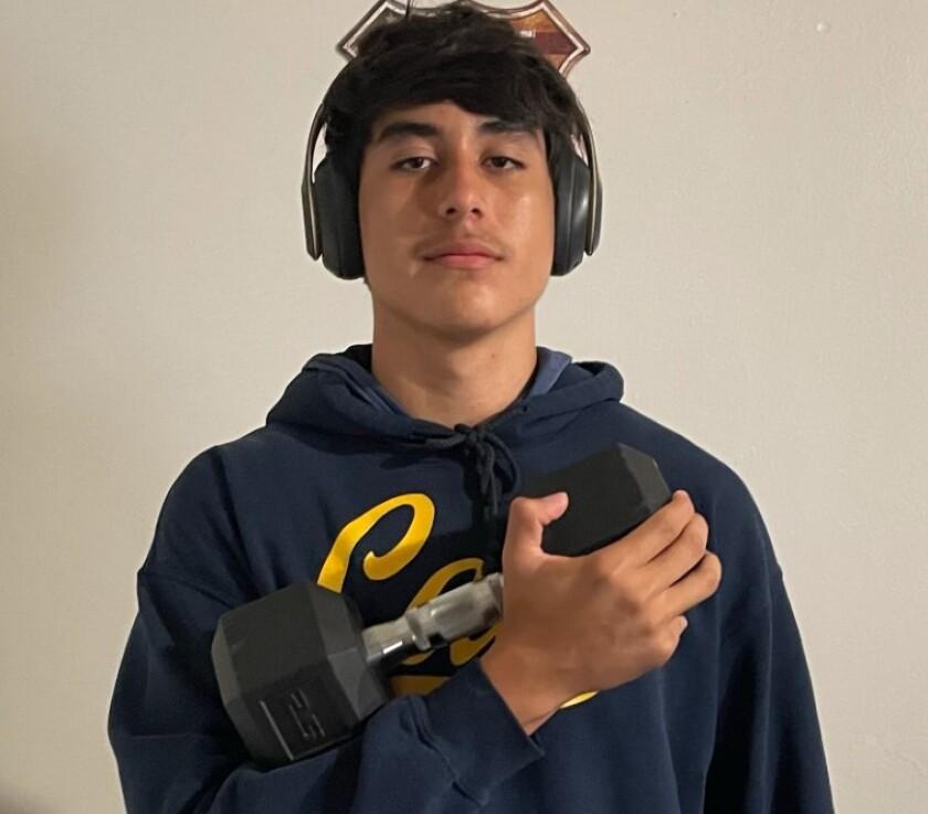 Los Angeles High's Sebastian Romero holds a dumbbell.