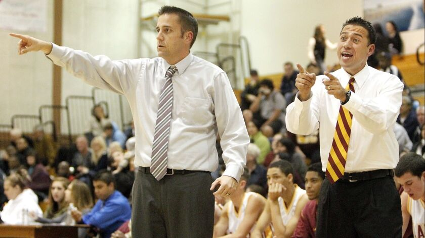 Ocean View High co-coaches Tim Walsh, left, and Jimmy Harris, right, during the second half against