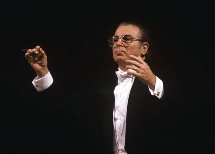 This undated photo released by the La Scala theater shows Giulio Bertola. The La Scala opera house says a long-time choir director Giulio Bertola has died after a long illness. La Scala on Tuesday, Dec. 2, 2008 confirmed Bertola's death Sunday. The Milanese opera house did not elaborate the cause o