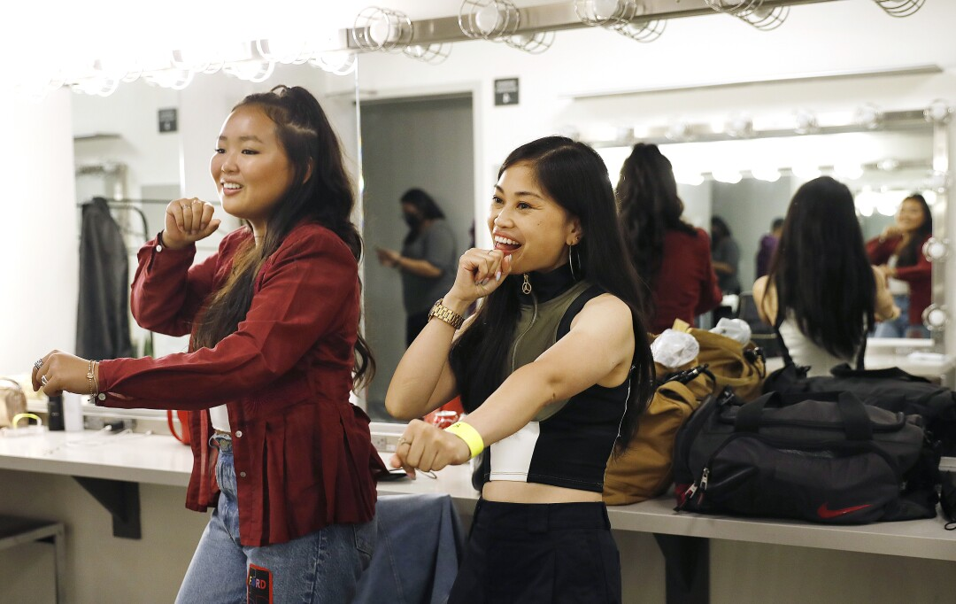 Ella Jay Basco, left, and Ruby Ibarra rehearse in the dressing room.