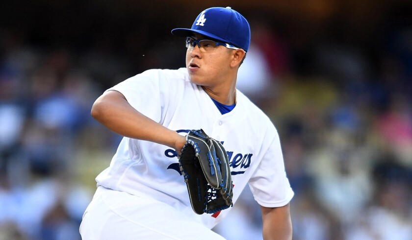 Dodgers pitcher Julio Urias makes a pitch against the Washington Nationals in the first inning on June 22 at Dodger Stadium.