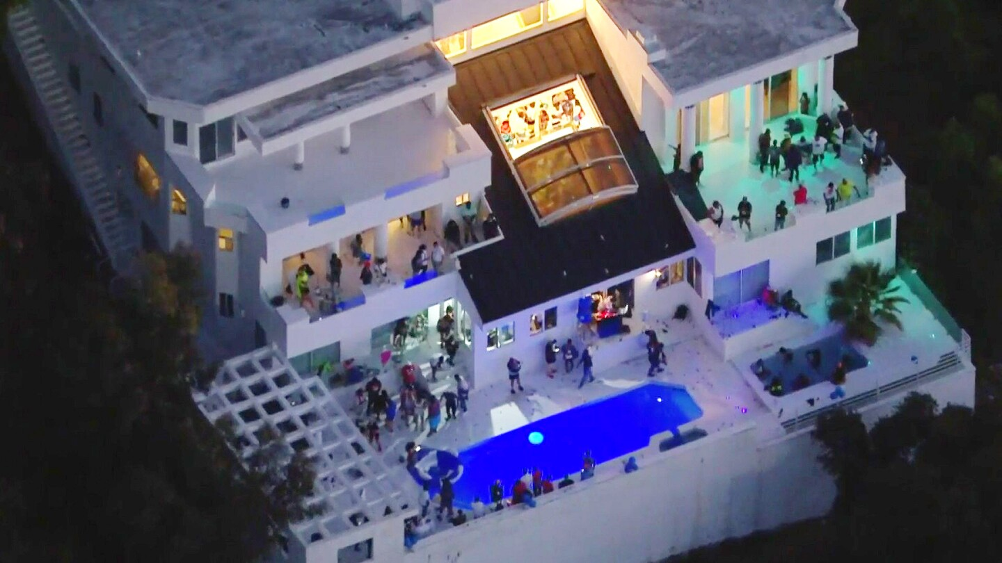 Aerial view of a large house party on Mulholland Drive in Beverly Crest, where three people were shot.