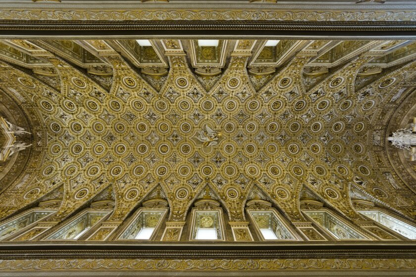 This July 9, 2015 photo shows a view of the ceiling of the Pauline Chapel inside the Quirinale Presidential Palace in Rome. The Quirinale palace, built in 1583 by Pope Gregory XIII on the remains of ancient Roman baths, has housed in the past thirty Catholic popes, four kings of Italy and twelve presidents of the Italian Republic. (AP Photo/Domenico Stinellis)