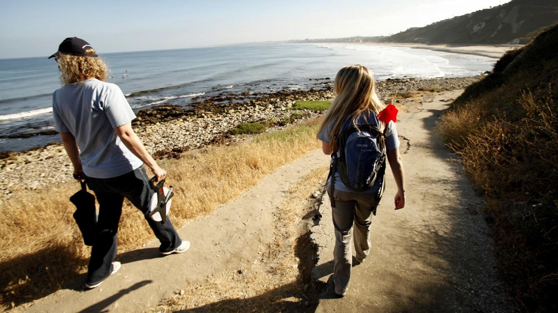 Coastal activists head to the beach at Malaga Cove.