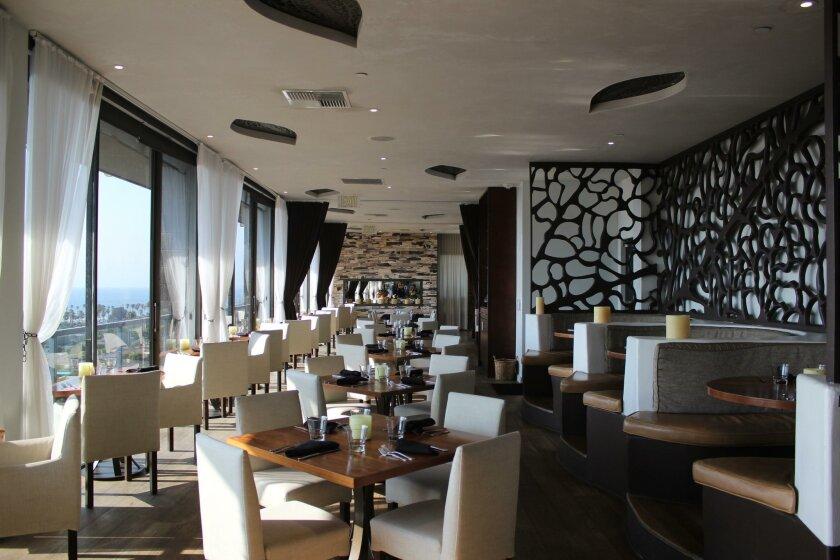 The top floor restaurant, Cusp, features coastal cuisine and ocean views.