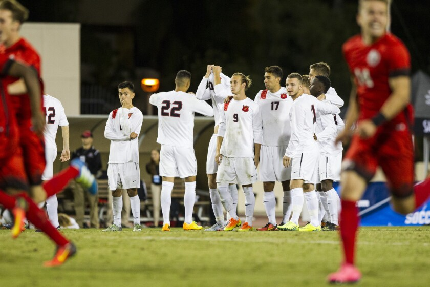 The SDSU men's soccer team looks on in defeat after falling to UNLV in penalty kicks. Photo by Chadd Cady