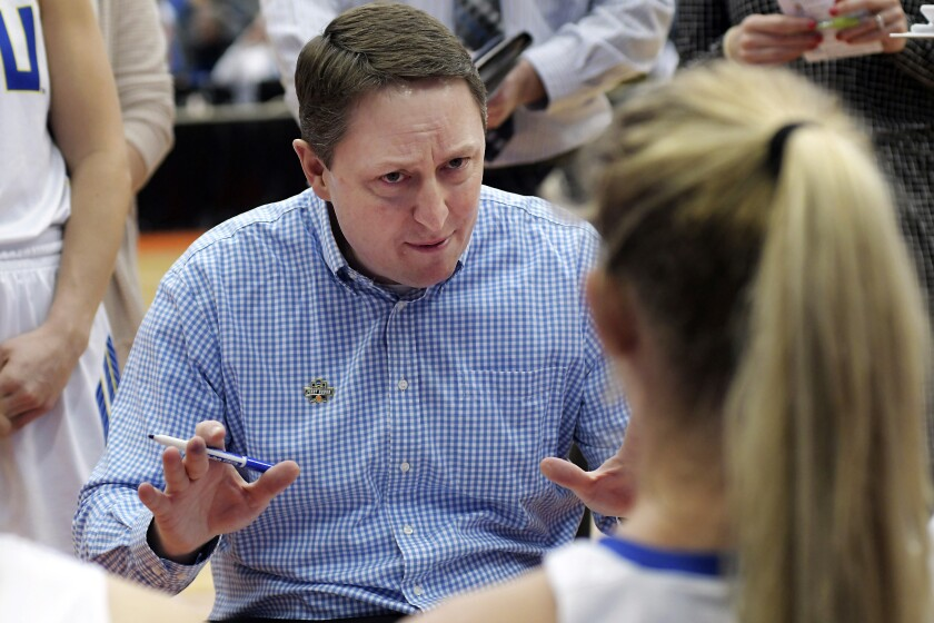 FILE - In this March 23, 2019, file photo, South Dakota State head coach Aaron Johnston speaks with is team during a timeout in a first-round game against Quinnipiac in the NCAA women's college basketball tournament in Syracuse, N.Y. South Dakota State entered The Associated Press Top 25 on Monday, Dec. 7, 2020, coming in at No. 22. (AP Photo/Heather Ainsworth, File)