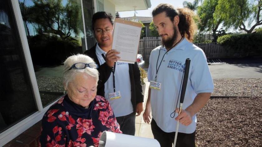 Last December, registered voter Margo Rogers signed a petition solicited by Mark Woodard, with Glenn Cariaga, center, both from Vistans For Better Safety and Services. The petition called for legalizing, regulating and taxing medical marijuana dispensaries in Vista.