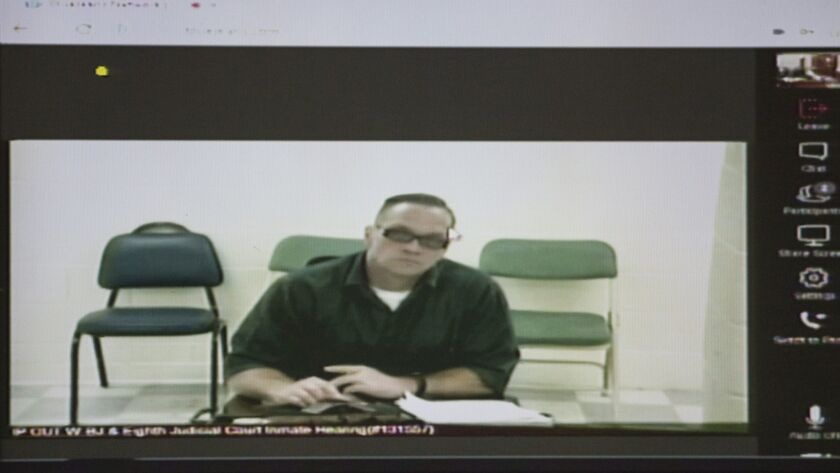 Nevada death row inmate Scott Dozier appears at a court hearing via video in December.