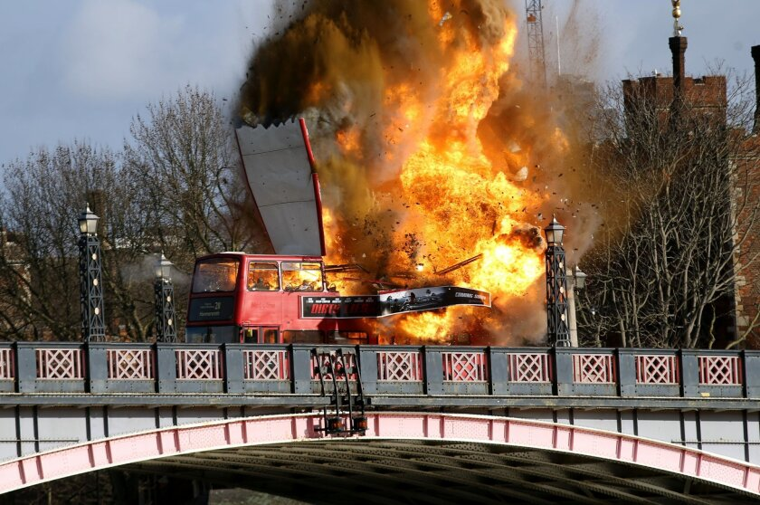 "A bus explodes on Lambeth Bridge, during filming for Jackie Chan's new film The Foreigner, in London, Sunday, Feb.  7, 2016. A bus has exploded in central London — but this time it's only for a movie. City officials Sunday reassured the public that the explosion was a movie stunt for ""The Foreigner"