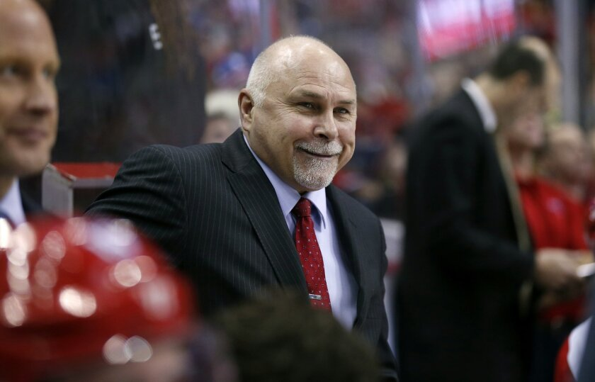 FILE - In this Jan. 17, 2016, file photo, Washington Capitals head coach Barry Trotz smiles in the bench in the first period of an NHL hockey game against the New York Rangers in Washington. Trotz will be coaching the Metropolitan Division in the All-Star Game on Sunday, Jan. 31, in Nashville where he helped hockey start and grow as the first coach of the Nashville Predators. (AP Photo/Alex Brandon, File)