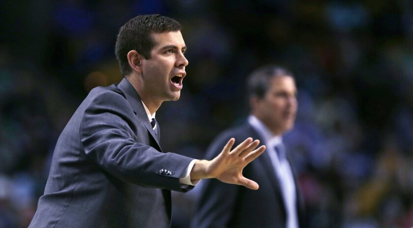Boston Celtics head coach Brad Stevens calls to his players during the first quarter of an NBA basketball game against the Washington Wizards in Boston, Friday, Nov. 6, 2015. (AP Photo/Charles Krupa)