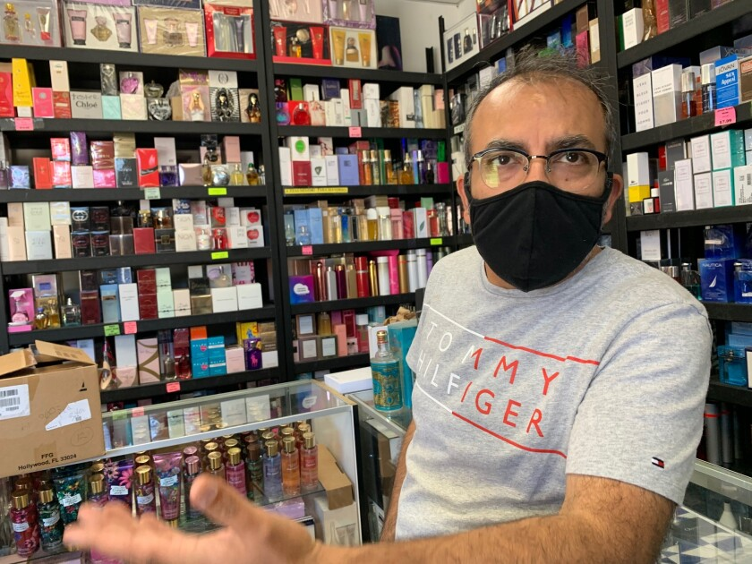 Sunil Gakhreja, who goes by Sunny, spends the afternoon in his perfume shop on San Ysidro Boulevard.