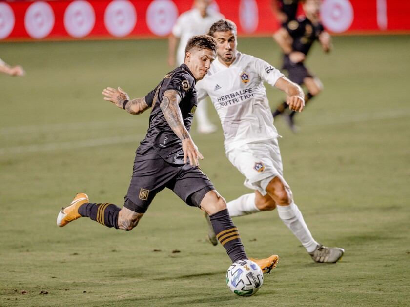 Brian Rodriguez runs alongside a Galaxy player.