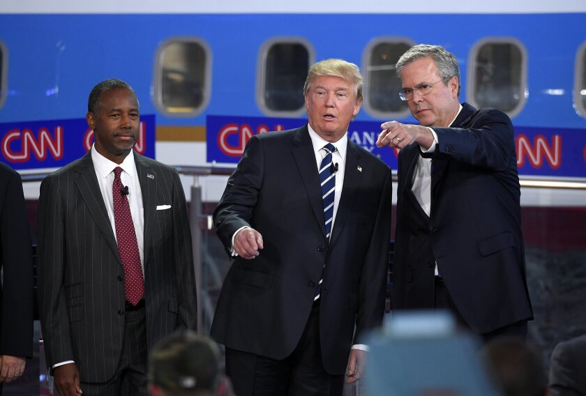 In this photo taken Wednesday, Sept. 16, 2015, Republican presidential candidates, from left, Ben Carson, Donald Trump, and former Florida Gov. Jeb Bush chat during the CNN Republican presidential debate at the Ronald Reagan Presidential Library and Museum in Simi Valley, Calif. Donald Trump's rivals emerged from the second Republican debate newly confident that the brash billionaire will fade if the primary takes a more substantive turn and that they can play a role in taking him down without hurting their own White House ambitions. Yet in a race that has so far defied standard political logic, that may be little more than wishful thinking. (AP Photo/Mark J. Terrill)