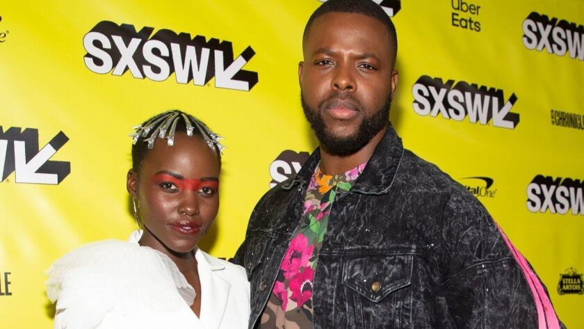 """Actress Lupita Nyong'o and actor Winston Duke attend the """"Us"""" premiere during the 2019 SXSW Film Festival at the Paramount Theatre in Austin, Texas."""