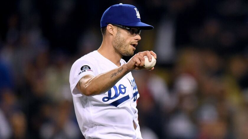 Dodgers reliever Joe Kelly reacts after the final out of a 9-4 victory over the Atlanta Braves on May 8. Kelly has given up runs in eight of his 15 appearances this season.