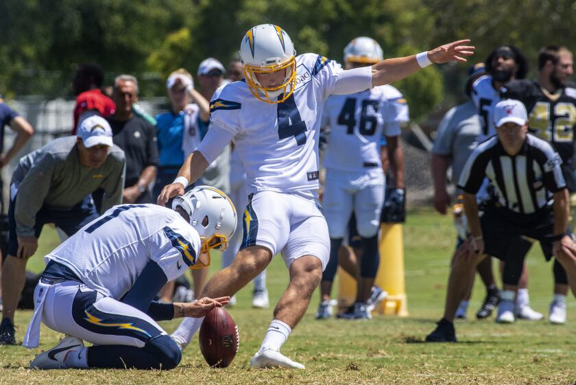 Chargers kicker Michael Badgley attempts a field goal during a team practice session in August.