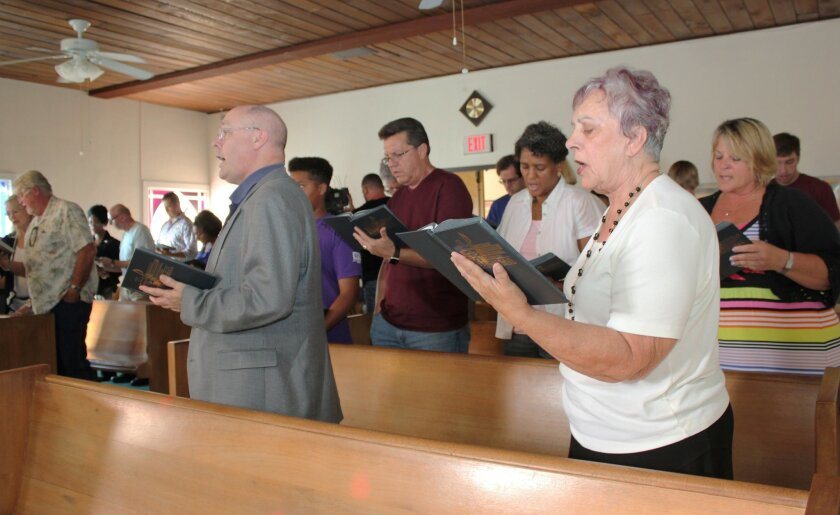Attendees sing hymns and listen to words from several La Jolla faith community leaders during the service at Prince Chapel A.M.E. Church, June 19.