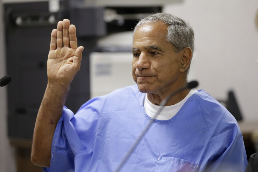 Sirhan Sirhan raises his right hand as he is sworn in during a parole hearing