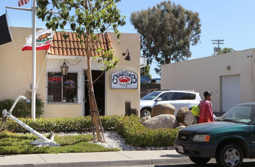Exterior view of The Original Sand Crab Tavern that's in an area of light industrial buildings in Escondido.