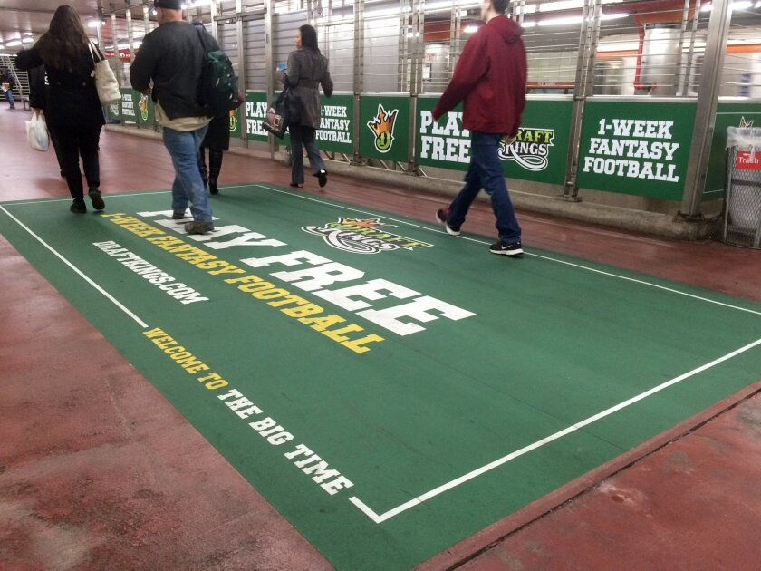 In this photo taken on Tuesday, Dec. 1, 2015, an ad for daily fantasy sports operator DraftKings is displayed in a subway station in Philadelphia. (AP Photo/Oskar Garcia)