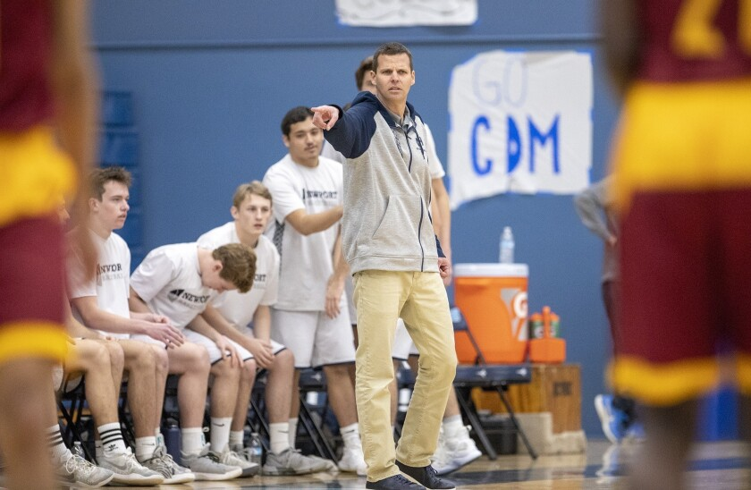 Newport Harbor's head coach Robert Torribio gives diections to his team during a game against Rivers