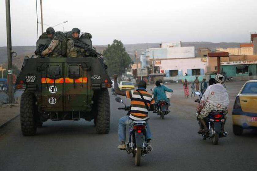 A motorcyclist shows his support to French troops in Bamako, Mali's capital.