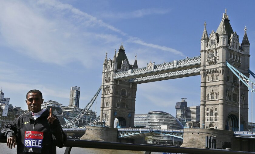"FILE- In this Wednesday, April 20, 2016 file photo, Kenensia Bekele of Ethiopia poses for photographers ahead of the London marathon at the Tower Bridge in London. Bekele says his exclusion from Ethiopia's marathon team for the Olympics is ""unjust"" and has called the selection criteria the national"