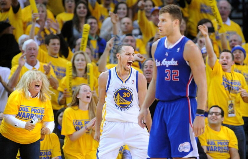 Golden State's Stephen Curry reacts near Clippers' Blake Griffin after blocking a shot in Game 4 of the NBA Western Conference playoffs on April 27, 2014.