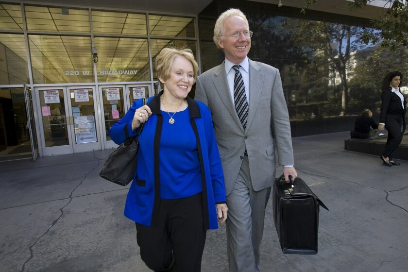 Nancy Graham left San Diego Superior Court yesterday with Paul Pfingst, her attorney, after a hearing. (Nelvin C. Cepeda / Union-Tribune)