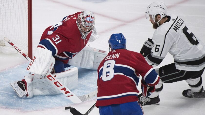 Montreal Canadiens goaltender Carey Price makes a save against Los Angeles Kings' Jake Muzzin (6) as