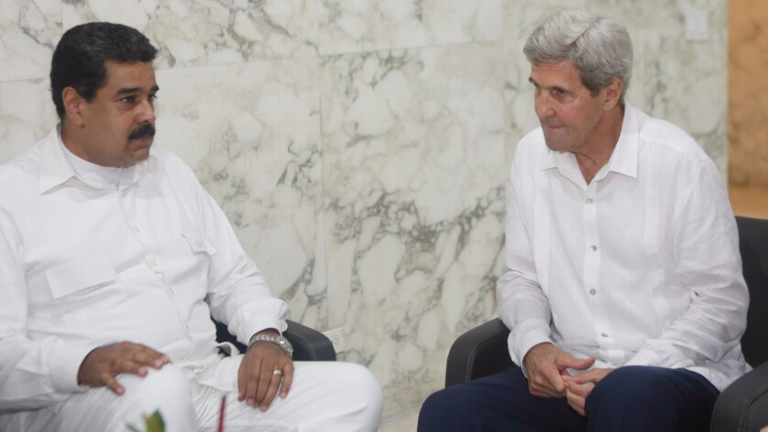 Picture released by the Venezuelan presidency showing Venezuelan President Nicolas Maduro (left) talking with U.S. Secretary of State John Kerry (right) before the peace agreement signing ceremony in Cartegena.