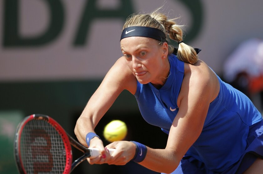 Petra Kvitova of the Czech Republic returns the ball to Taiwan's Su-Wei Hsieh  during their second round match of the French Open tennis tournament at the Roland Garros stadium, Wednesday, May 25, 2016 in Paris.  (AP Photo/Christophe Ena)
