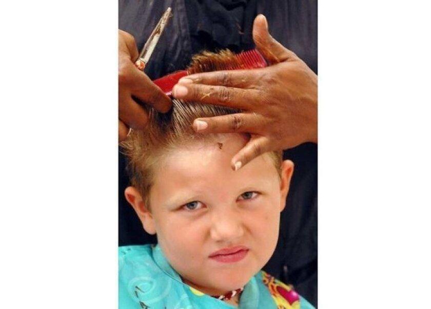J.C. Penney hopes free-haircut program boosts sales