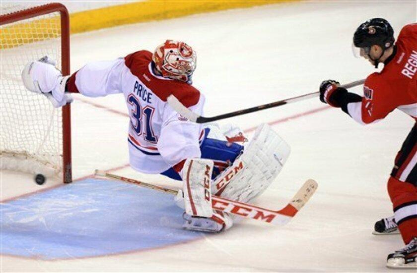 Ottawa Senators' Peter Regin, right, puts his winning shootout attempt past Montreal Canadiens goaltender Carey Price during their NHL hockey game, Monday, Feb. 25, 2013, in Ottawa, Ontario. The Senators won 2-1. (AP Photo/The Canadian Press, Sean Kilpatrick)