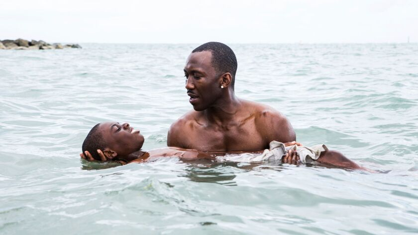 "Alex Hibbert and Mahershala Ali in a scene from the film, ""Moonlight."""