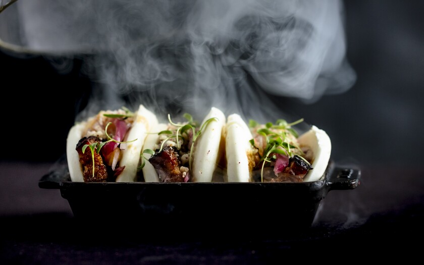 """Smoking turns pork belly into """"instant"""" bacon bao buns, with five-spice, sweet chili sauce and chili water, at International Smoke."""