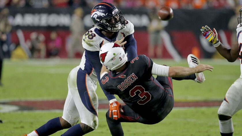 Denver Broncos linebacker Von Miller (58) hits Arizona Cardinals quarterback Josh Rosen (3) as he throws during the second half.