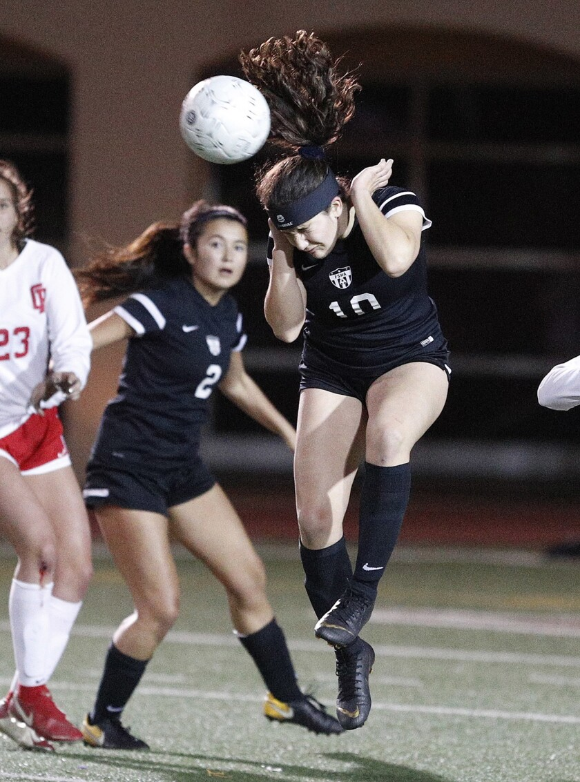 Flintridge Sacred Heart Academy soccer player Helena Locateli, right, was named the Mission League's Most Valuable Player for the first time.