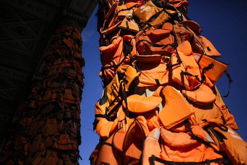 A art installation by Chinese artist Ai Weiwei with life  vests used by refugees and collected on  the Greek island of Lesbos is set up at the Konzerthaus  Berlin (Concert Hall Berlin) for the Cinema For Peace gala alongside the 2016 Berlinale Film Festival in Berlin, Saturday, Feb. 13, 2016. The c