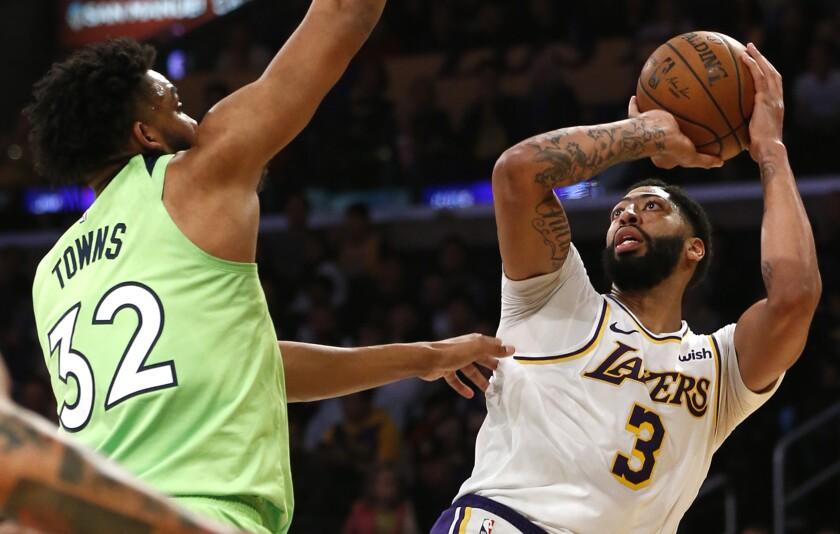 Anthony Davis had 50 points for the Lakers against the Timberwolves on Sunday.