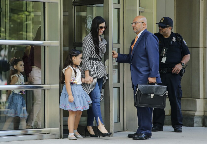 """Emma Coronel, wife of Joaquin """"El Chapo"""" Guzman, leaves federal court in Brooklyn, N.Y., with her twin daughters after a hearing in the case of her husband on June 26."""