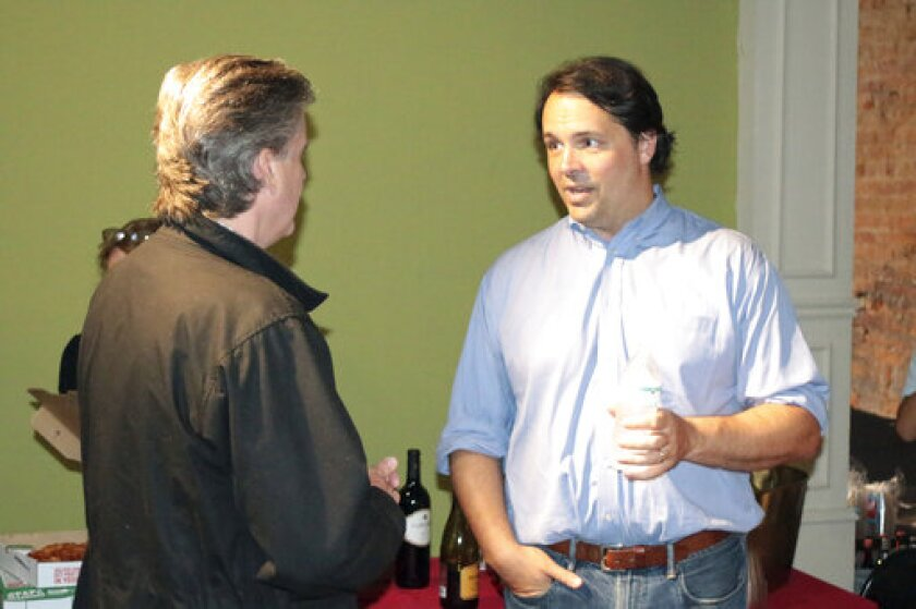 Republican congressional candidate John Cowan greets supporters Tueaday, June 9, 2020 in Rome, Georgia at an election night party. Cowan is in an Aug. 11 runoff for the Republican nomination in northwest Georgia's 14th Congressional District against Marjorie Taylor Greene, who has come under fire for remarks she made in videos she recorded. (Jeremy Stewart/Rome News-Tribune via AP)
