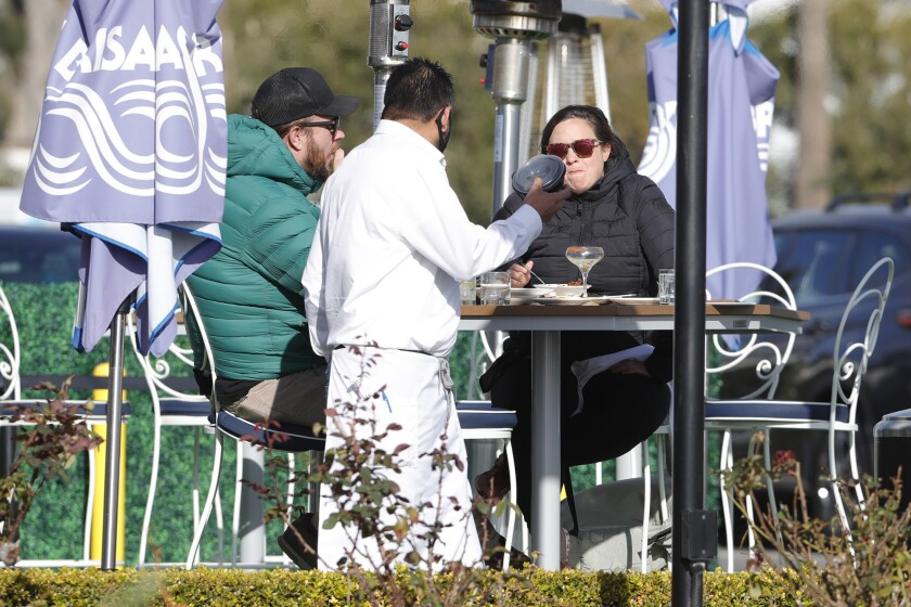 Diners at Las Brisas in Laguna Beach enjoy lunch outside Monday.