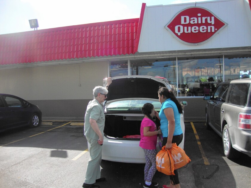 Sister Sharon Altendorf, left, stops for sundaes with Karen and daughter Joanna, newly released from an immigrant family detention center in Karnes City, Texas.